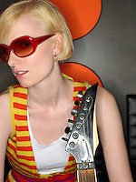 Young woman in sunglasses with guitar portrait