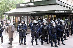 May 2, 2019 - Paris, Ile-de-France (region, France - A Mc Donald's protected by a large group of police officers on the demonstration of May 1, 2019 (Credit Image: © Laurent Paillier/Le Pictorium Agency via ZUMA Press)