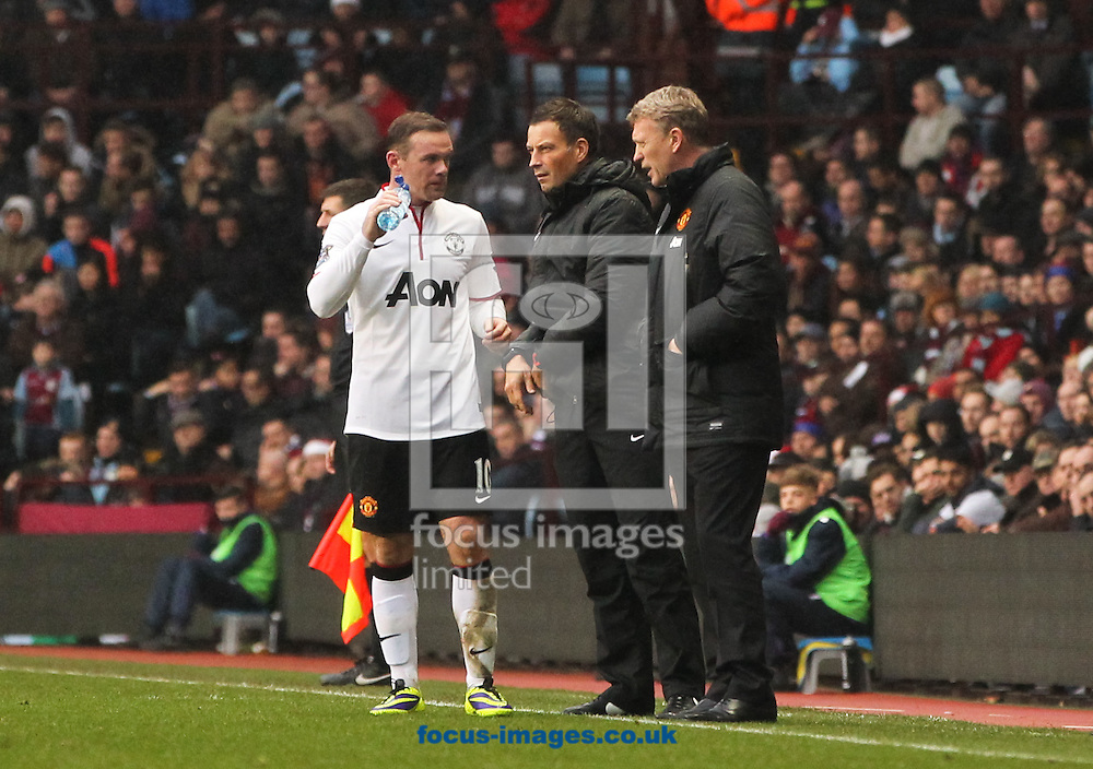 Picture by Tom Smith/Focus Images Ltd 07545141164<br /> 15/12/2013<br /> Wayne Rooney (centre left) of Manchester United talks to Manchester United manager David Moyes (centre right) during the Barclays Premier League match at Villa Park, Birmingham.