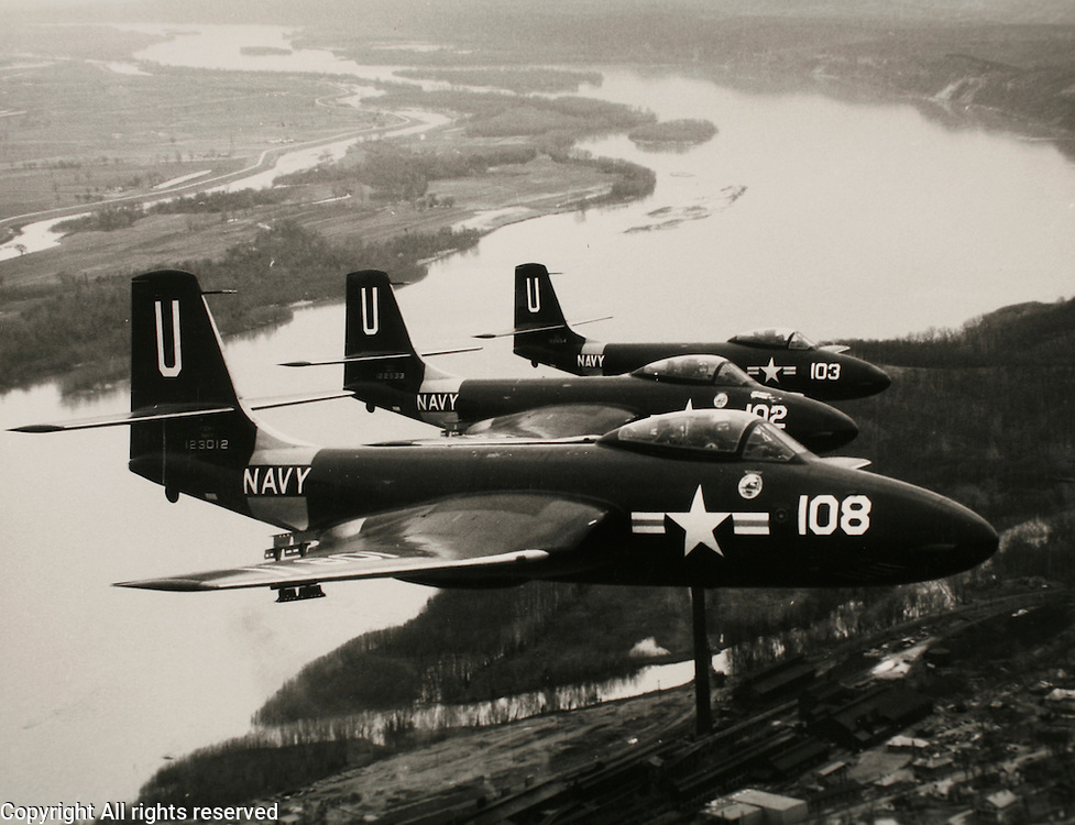 """""""F2H-1s fly in formation over the Mississippi river in Eastern Missouri. Altitude 3000 feet."""" ..From wikipedia, """"F2H Banshee was a military carrier-based jet fighter aircraft, used by the United States Navy from 1948 to 1959"""""""