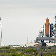 Space Shuttle Discovery on launch pad 39A being prepared for launch.