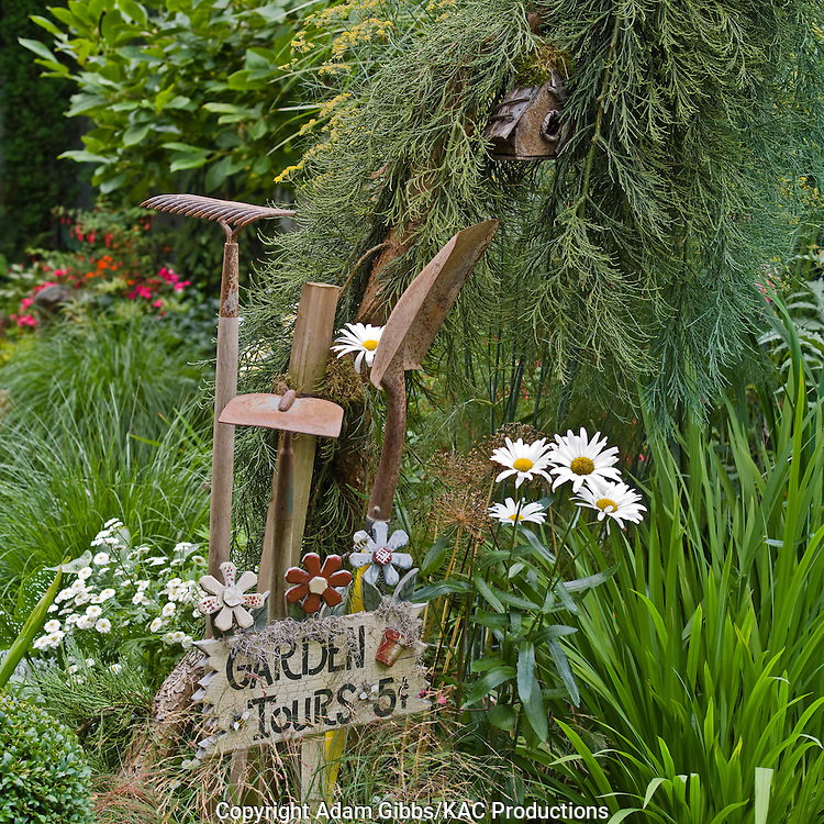 old garden tools and whimsical sign