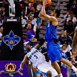 November 17, 2010; New Orleans, LA, USA; New Orleans Hornets point guard Chris Paul (3) draws a charging foul from Dallas Mavericks center Tyson Chandler (6) during the second half at the New Orleans Arena. The Hornets defeated the Mavericks 99-97. Mandatory Credit: Derick E. Hingle