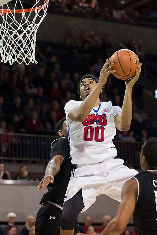 DALLAS, TX - JANUARY 7: Ben Moore #00 of the SMU Mustangs drives to the basket against the Cincinnati Bearcats on January 7, 2016 at Moody Coliseum in Dallas, Texas.  (Photo by Cooper Neill/Getty Images) *** Local Caption *** Ben Moore