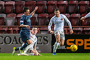 Joe Cardle (#32) of Partick Thistle FC is brought down in the box by John Souttar (#4) of Heart of Midlothian during the William Hill Scottish Cup quarter final replay match between Heart of Midlothian and Partick Thistle at Tynecastle Stadium, Gorgie, Edinburgh Scotland on 12 March 2019.