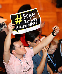 May 18, 2017 - Hamburg, Germany - Journalists show solidarity for Turkish journalist being imprisoned without due process, by holding up signs with message: # FREE Turkey Journalists at the Town Hall Meeting: Building The Journalism WE Need, where hundreds of top editors from all over the globe gathered for IPI (International Press Institute) 2017 World Congress. (Credit Image: ? Scott Mc Kiernan/ZUMA Wire)