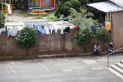 Clothes hanging out to dry in front of Missao Paz, São Paulo, Brazil.<br /> <br /> Missao Paz provides advice and support on employment, health, family, community and education. They also have residential quarters where people can stay when they have no where else. <br /> <br /> Their mission is to welcome, understand, integrate and celebrate the lives of immigrants and refugees, dreaming of a universal citizenship.