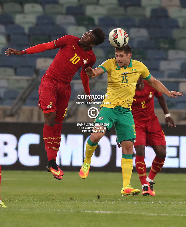 Samuel Tetteh of Ghana and Dean Furman of South Africa jump to head the ball during the international friendly match between South Africa ( Bafana Bafana ) and Ghana at the Moses Mabhida stadium in Durban, South Africa on the 11th October 2016<br /> <br /> Photo by:   Steve Haag / Real Time Images