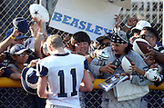 Dallas Cowboys wide receiver Cole Beasley (11) signs autographs for fans after the second day of the Dallas Cowboys 2016 NFL training camp football practice held on Sunday, July 31, 2016 in Oxnard, Calif. (©Paul Anthony Spinelli)