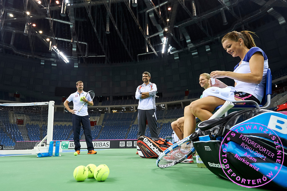 (R) Agnieszka Radwanska and (C) Urszula Radwanska and (C) Tomasz Wiktorowski trainer coach all from Poland during official training session three days before the Fed Cup / World Group 1st round tennis match between Poland and Russia at Krakow Arena on February 4, 2015 in Cracow, Poland.<br /> <br /> Poland, Cracow, February 4, 2015<br /> <br /> Picture also available in RAW (NEF) or TIFF format on special request.<br /> <br /> For editorial use only. Any commercial or promotional use requires permission.<br /> <br /> Mandatory credit:<br /> Photo by &copy; Adam Nurkiewicz / Mediasport