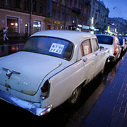 White Nights, the long summer nights when daylight lasts 24 hours. A Volga for sale on the street in Saint Petersburg, Санкт-Петербург, the second largest city in Russia, located on the Neva River near the Baltic Sea.<br /> Photography by Jose More