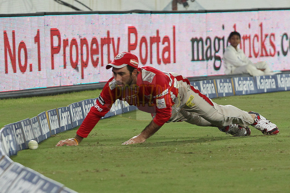 Glenn MAXWELL of the Kings XI Punjab tries in vain to save the boundary during the second semi final match of the Oppo Champions League Twenty20 between the Kings XI Punjab and the Chennai Superkings held at the Rajiv Gandhi Cricket Stadium, Hyderabad, India on the 2nd October 2014<br /> <br /> Photo by:  Ron Gaunt / Sportzpics/ CLT20<br /> <br /> <br /> Image use is subject to the terms and conditions as laid out by the BCCI/ CLT20.  The terms and conditions can be downloaded here:<br /> <br /> http://sportzpics.photoshelter.com/gallery/CLT20-Image-Terms-and-Conditions-2014/G0000IfNJn535VPU/C0000QhhKadWcjYs