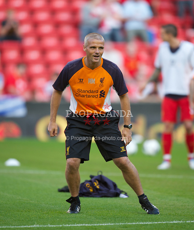 LIVERPOOL, ENGLAND - Thursday, August 9, 2012: Liverpool's Under-18s coach Mike Marsh warms up before the UEFA Europa League Third Qualifying Round 2nd Leg match against FC Gomel at Anfield. (Pic by David Rawcliffe/Propaganda)