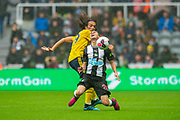 Matteo Guendouzi (#29) of Arsenal FC fouls Miguel Almiron (#24) of Newcastle United FC during the Premier League match between Newcastle United and Arsenal at St. James's Park, Newcastle, England on 11 August 2019.