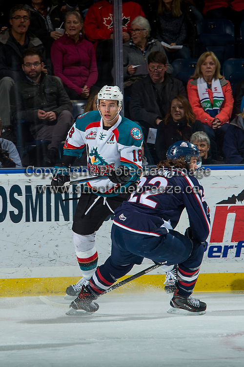 KELOWNA, CANADA - JANUARY 3: Nolan Yaremko #22 of the Tri-City Americans checks Carsen Twarynski #18 of the Kelowna Rockets on January 3, 2017 at Prospera Place in Kelowna, British Columbia, Canada.  (Photo by Marissa Baecker/Shoot the Breeze)  *** Local Caption ***