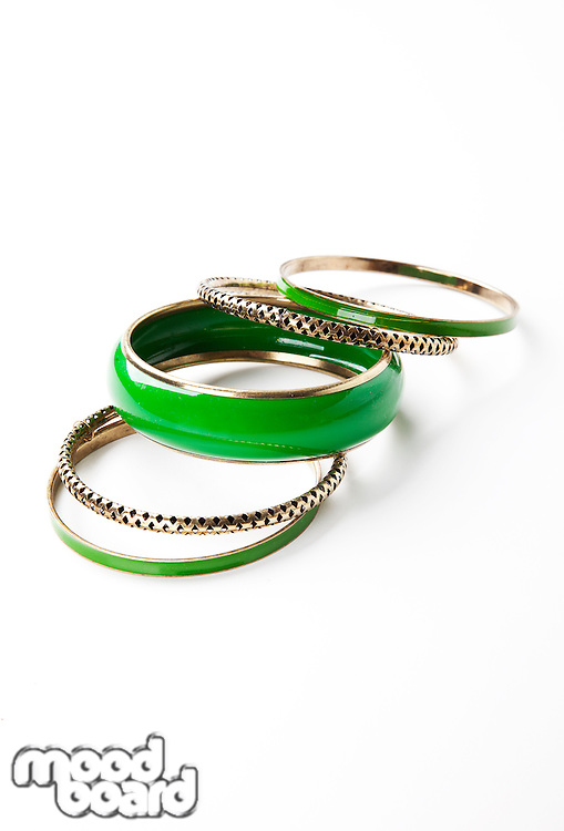 Green bangles over white background
