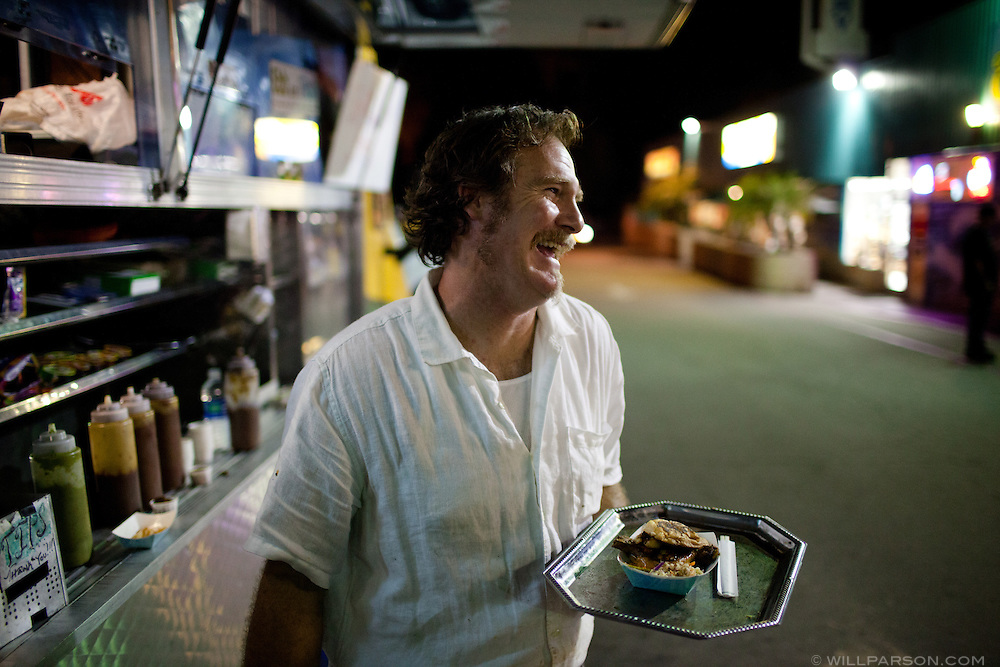 "David Long, known as Chef Dave, serves his own gourmet street food from his mobile restaurant parked outside Duke's Cardiff Office bar in Cardiff By The Sea, March 26, 2010. Long, a professional chef, owns and operates ""Dave de Jour,"" which caters to the bar-hopping crowd in Leucadia, Encinitas and Cardiff By The Sea."