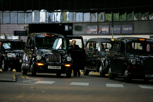 LONDON SCENES: Cabs London bridge station by Neville Elder