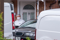 © Licensed to London News Pictures. 20/10/2019. Milton Keynes, UK. A forensic investigator stands outside a blood stained door as police investigate the double murder of two 17-year-old boys. Thames Valley Police and South Central Ambulance Service were called to a property in Archford Croft, Emerson Valley, Milton Keynes, just before midnight following reports of a stabbing having taken place. Two adult males have also been injured in the incident. Photo credit: Peter Manning/LNP
