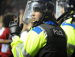 A police officer keeps fans apart  - Photo mandatory by-line: Dougie Allward/JMP - Tel: Mobile: 07966 386802 04/09/2013 - SPORT - FOOTBALL -  Ashton Gate - Bristol - Bristol City V Bristol Rovers - Johnstone Paint Trophy - First Round - Bristol Derby