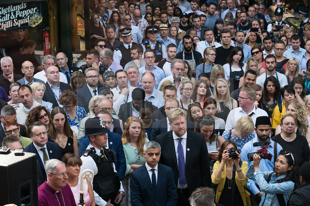© Licensed to London News Pictures. 14/06/2017. London, UK. Shop owners and stall holders observe a minutes silence as Borough Market re-open on the first day of trading after the terrorist attacks 3rd June which left eight people dead and three terrorists shot dead by police. Photo credit: Ray Tang/LNP