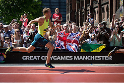 © Licensed to London News Pictures . 17/05/2014 . Manchester , UK . Crowd on Deansgate watch Great Britain's SEBASTIAN RODGER in the Men's 200m hurdles . The Great City Games in Manchester , with athletics on a track along Deansgate and Pole Vault and Long Jump in Albert Square . Photo credit : Joel Goodman/LNP