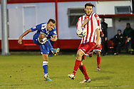 Jake Reed of Lowestoft Town (left) shoots during the Conference North match at St. James Park, Brackley<br /> Picture by David Horn/Focus Images Ltd +44 7545 970036<br /> 24/01/2015