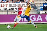 WAALWIJK, RKC Waalwijk - Ajax, voetbal Eredivisie, seizoen 2013-2014, 02-04-2014, Mandemakers Stadion, Ajax speler Davy Klaassen (L) scoort de 0-2, RKC Waalwijk speler Remy Amieux (R) is te laat.