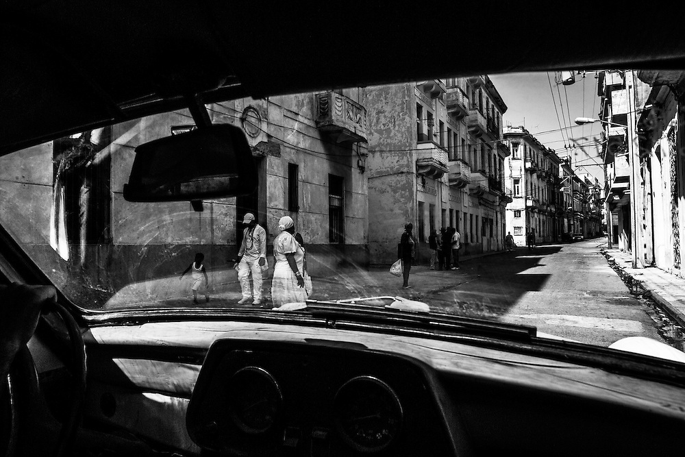 Where: Havana, Cuba.<br /> <br /> I truly love this image. It captures the essence of Havana streets. Empty street, locals people.