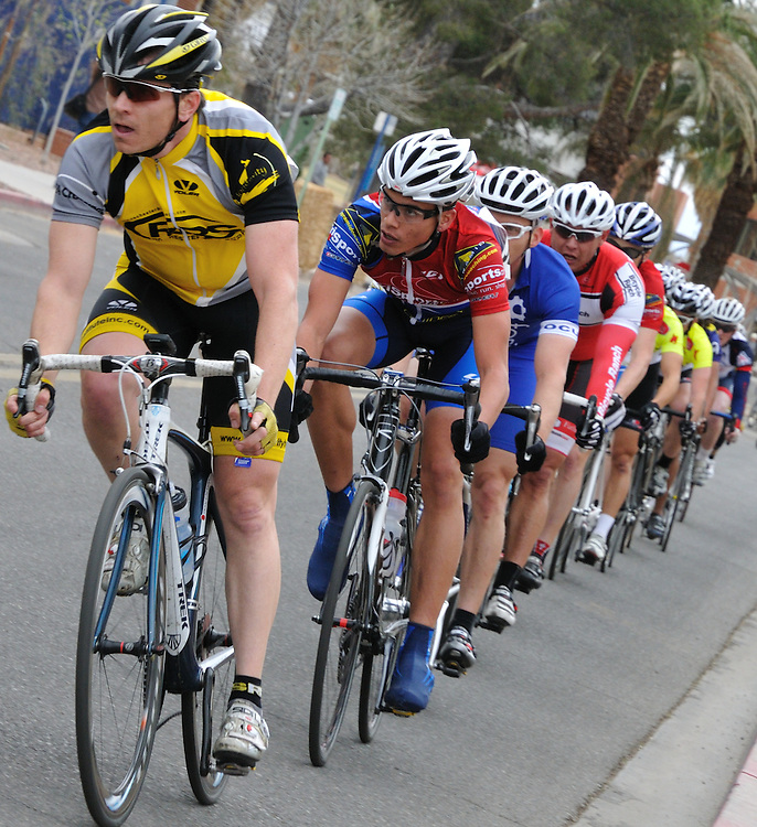 Rider paceline in the 2011 UA Criterium bicycle race, Tucson, Arizona. Bike-tography by Martha Retallick.