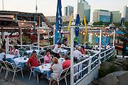Copa Cagrana - Sunken City, Donauinsel,  Restaurant bei Dämmerung, Wien, Österreich .|.Copa Cagrana - Sunken City, Danube at dusk, Vienna, Austria..