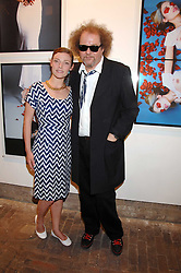 MIKE FIGGIS and CAMILLA RUTHERFORD at the launch of 'Glenmorangie 5 Senses' an exhibition of photographs by Mike Figgis held at Proud Camden, Stables Market, London NW1 on 13th May 2008.<br />