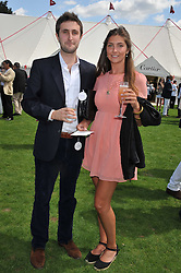 PRINCESS AUGUSTA VON PREUSSEN and CASPAR HELMORE at the 27th annual Cartier International Polo Day featuring the 100th Coronation Cup between England and Brazil held at Guards Polo Club, Windsor Great Park, Berkshire on 24th July 2011.