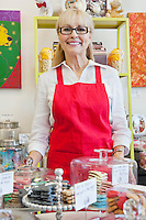 Portrait of senior owner of pet shop