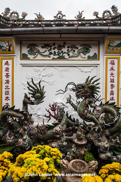 Phuoc Kien <br /> Dragons - Phuoc Kien Assembly Hall, Hoi An - Phuoc Kien Assembly Hall was founded in 1690 by Fukien Chinese immigrants in Hoi An.  It contains Thien Hau goddess of the sea protector, protector of sailors. Phuoc Kien is probably the most elaborate of the assembly halls, temples and pagoda of Hoi An with more lavish and resplendent architecture, bas relief, murals, huge spiral incense coils, and large dragons.