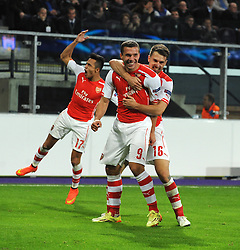 Arsenal's Lukas Podolski celebrates his late goal with Arsenal's Aaron Ramsey - Photo mandatory by-line: Dougie Allward/JMP - Mobile: 07966 386802 - 22/10/2014 - SPORT - Football - Anderlecht - Constant Vanden Stockstadion - R.S.C. Anderlecht v Arsenal - UEFA Champions League - Group D