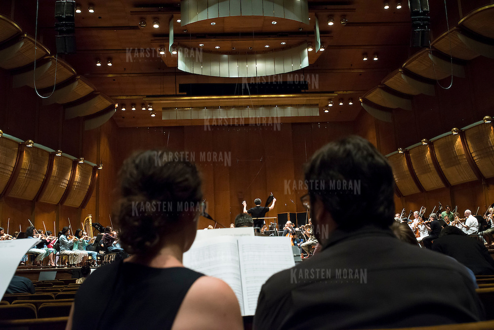 June 3, 2014 - New York, NY : Composers Julia Adolphe, foreground left, and Max Grafe, foreground right, listen during a rehearsal of one of their colleagues' works by the New York Philharmonic at Avery Fisher Hall on Tuesday. Three works by little-known composers, such as Adolphe and Grafe, will be selected for inclusion in the New York Philharmonic's Biennial. CREDIT: Karsten Moran for The New York Times