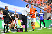 Blackpool manager Gary Bowyer talks to Brad Potts (8) of Blackpool during a break in play during the EFL Sky Bet League 2 play off final match between Blackpool and Exeter City at Wembley Stadium, London, England on 28 May 2017. Photo by Graham Hunt.