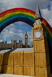 © Licensed to London News Pictures. 27/09/2012. LONDON, UK. A cake of Big Ben clock tower is seen with it's full size counterpart in Central London today (27/9/12). The cake, thought to be the largest of London's landmark clock tower, was made for the annual 'Big Hour Cake Sale' taking place in Canary Wharf from the 22nd to the 28th of October in aid of the Rainbow Trust, a charity that helps support families of children with life threatening or terminal illness. Photo credit: Matt Cetti-Roberts/LNP