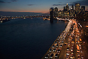 evening rush hour East River Highway New York City with Brooklyn Bridge in the background