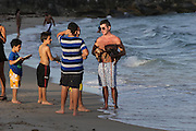 Simon Cowell spends an afternoon at the beach with Lauren Silverman and their newborn son Eric, 9 days old. Eric was spotted bottled feeding with Mom Lauren while Simon took his beloved dogs, Sqiddly and Diddly, for a walk on the sand. The new parents were also seen cuddling on their sun lounger while Eric slept next to them. Miami Beach, FL. 23rd February 2014.<br /> ©Exclusivepix