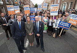 Repro Free: 24/09/2014 NAGP spokespersons Dr Ruairi Hanley, GP, Drogheda, Co. Louth and Dr Ciara Kelly, GP Greystones, Co. Wicklow are pictured with and Dr Conor McGee, GP Scarriff, Co Clare and NAGP President and fellow GS's as for the first time in the history of the state, GPs have been motivated to protest as patient safety is now at risk. GPs (as part of NAGP/ National Association of General Practitioners) outside Leinster House. Picture Andres Poveda