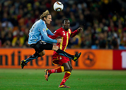 Diego Forlan of Uruguay vs Hans Sarpei of Ghana during to the 2010 FIFA World Cup South Africa Quarter Finals football match between Uruguay and Ghana on July 02, 2010 at Soccer City Stadium in Sowetto, suburb of Johannesburg. (Photo by Vid Ponikvar / Sportida)