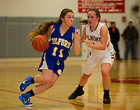 Gilford's Cassidy Bartlett and Belmont's Makayla Donovan at mid court during NHIAA Division III basketball Wednesday evening.  (Karen Bobotas/for the Laconia Daily Sun)