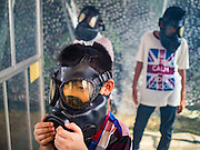 "14 JANUARY 2017 - BANGKOK, THAILAND: Thai children wear gas masks in a demonstration of gas masks during Children's Day activities at the King's Guard, 2nd Cavalry Division base in Bangkok. Thailand National Children's Day is celebrated on the second Saturday in January. Known as ""Wan Dek"" in Thailand, Children's Day is celebrated to give children the opportunity to have fun and to create awareness about their significant role towards the development of the country. Many government offices open to tours and military bases hold special children's day events. It was established as a holiday in 1955.       PHOTO BY JACK KURTZ"