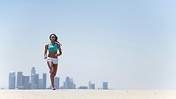 Woman Running, Cityscape in background