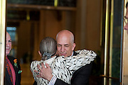 Photo by Matt Roth<br /> Assignment ID: 30148071A<br /> <br /> Michael Widomski, hugs Supreme Court Justice Ruth Bader Ginsburg after she served as officiant for his and David Hagedorn's, left, wedding at Fiola Restaurant in Washington, DC, Sunday, September 22, 2013. This was the second time Ginsburg's married a same sex couple since the repeal of DOMA.