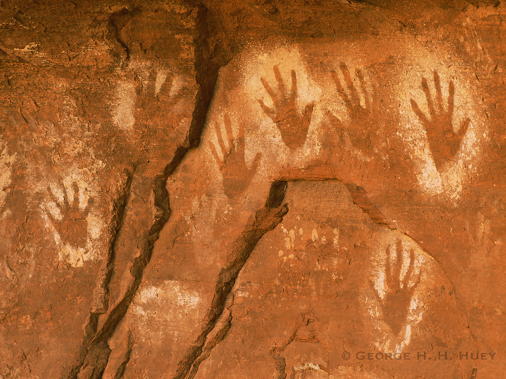 0100-1013 ~ Copyright: George H. H. Huey ~ Anasazi culture hand prints [pictographs]. ca. A.D. 1000's-1200's. Canyon de Chelly National Monument, Arizona.