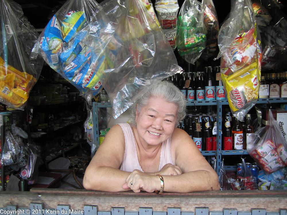 Shopkeeper in the Baan Krua community in Bangkok, Thailand. Love her smile!