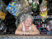 Shopkeeper in the Baan Krua community in Bangkok, Thailand. Love her smile!